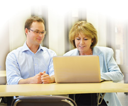Woman and man working together on a laptop