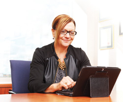 Professional woman working on a laptop in an office